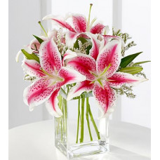 3 stargazer lilies in rectangular glass vase