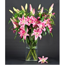 10 pink oriental lily in glass vase