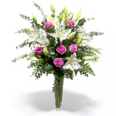 White Lilies with pink rose in vase