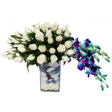 white roses with orchid in vase